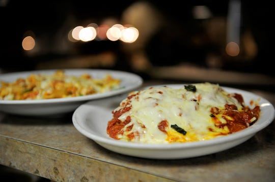 A plate of lasagne ready to head to the dining room at Little Italy Italian and Mediterranean Restaurant.