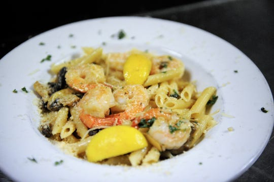 The New Shrimp Special with shrimp, garlic, mushrooms and herbs in a buttery lemon and Sherry sauce with Parmesan cheese at Little Italy Italian and Mediterranean Restaurant.