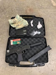 More than $1,200 in cash and a loaded handgun with extended magazine were seized in a drug raid in December.