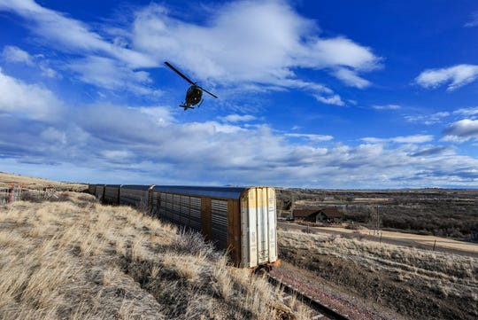 A helicopter from Malmstrom Air Force Base assists in the search effort for Amy Elaine Harding (Permann), 34, who was last seen Sunday night leaving her residence at 343 Flood Road on foot and heading southeast toward the Missouri River.