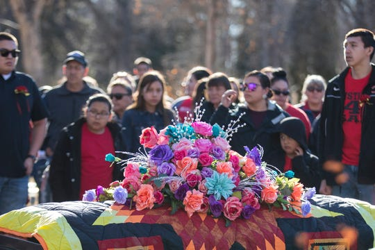 Flowers rest on top of Selena Not Afraid's casket during her funeral at the Fairview Cemetery in Hardin, Mont. on Sunday.