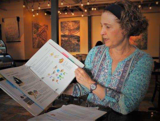 Guam Memorial Hospital health educator Renee Veksler shows A typical educational booklet Jan. 23.
