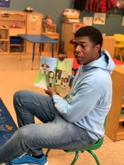"Noah Harris, former Oak Grove High student, now at Harvard, reads his book ""Successville"" to youngsters at TJ's Learning Center in Hattiesburg Jan. 22, 2020. Pearl River Community College donated the books as part of its Early Childhood Academy."