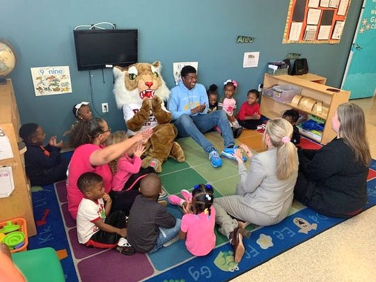 "Noah Harris, a former Oak Grove High student now at Harvard University, participates in story time Jan. 22, 2020, at TJ's Learning Center in Hattiesburg. His book, ""Successville,"" was used by Pearl River Community College as part of its Early Childhood Academy."