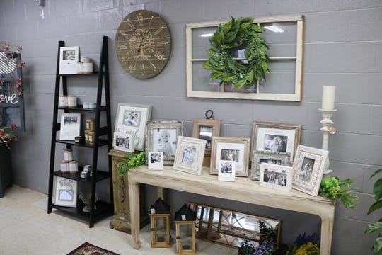 Photo frames, among other household items, are available at A New Leaf in Morganfield.