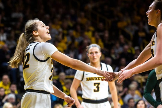 Iowa guard Kathleen Doyle, left, gets a high-five from Iowa forward Amanda Ollinger after drawing a foul during a NCAA Big Ten Conference women's basketball game, Sunday, Jan. 26, 2020, at Carver-Hawkeye Arena in Iowa City, Iowa.