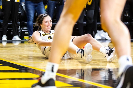 Iowa's McKenna Warnock (14) looks to the bench after drawing a foul during a NCAA Big Ten Conference women's basketball game, Sunday, Jan. 26, 2020, at Carver-Hawkeye Arena in Iowa City, Iowa.