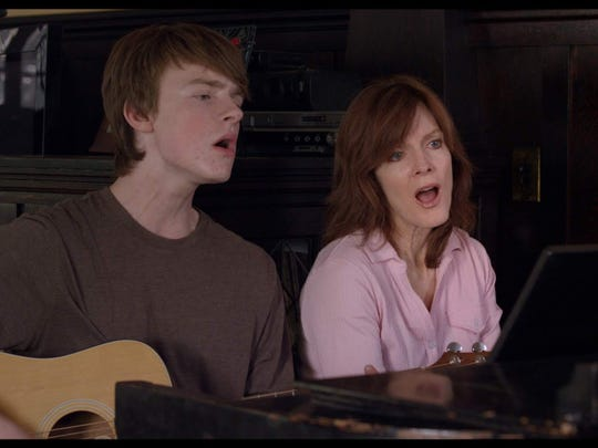 """Finneas O'Connell, left, and Maggie Baird are seen in """"Life Inside Out,"""" a film that screened at the 2013 Heartland Film Festival. O'Connell collaborated with his sister, Billie Eilish, on her Grammy-winning album, """"When We All Fall Asleep, Where Do We Go?"""""""
