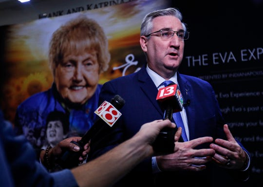 Gov. Eric Holcomb speaks with reporters during the reception at the Indiana History Center Monday, Jan. 27, 2020, to announce an exhibit devoted to Auschwitz survivor Eva Kor.