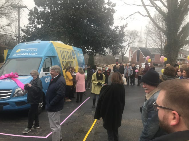 Supporters get ready to take a tour of the mobile unit moments after it was unveiled at Birth Choice on Saturday, January 25, 2020.