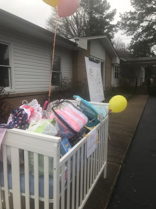 A crib of donated baby items sits outside Birth Choice of Jackson during the celebration of the unveiling of the mobile ultrasound unit.