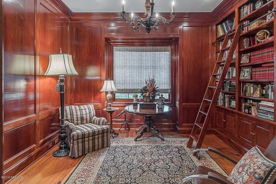 Just in time for Valentines Day, this romantic ambiance mansion has a to die for staircase, a library made of gorgeous Mahogany wood and 22 foot soaring ceiling. Custom detail at its finest situated on two lots in The Oaks, a gated subdivision, with detail factored in by love for this couples dream home. On the market for $899,000, this 3 bedroom, 3.5 bathroom mansion has 4,402 square feet of love to give.