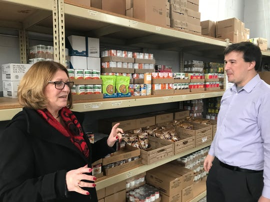 Lancaster-Fairfield County Community Action Agency Executive Director Kellie Ailes (left) is retiring from the agency Friday. In this photo, she talks about the CAA food pantry with new executive director Clinton Davis.