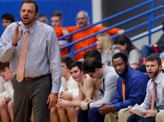Marshall County Zion Harmon's dad (blue shirt) Mike Harmon helps coach the team against Crawford County on Jan. 24, 2020.