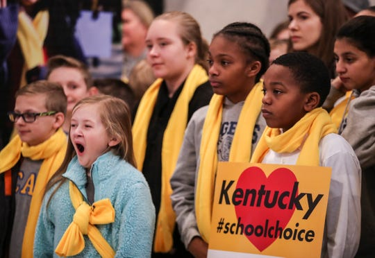 A young students yawns during the speeches as she and students from six parochial schools wore yellow scarves in solidarity for school choice and held signs during a small rally in the capitol rotunda as part of national School Choice week. Jan. 27, 2020