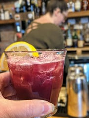 A blueberry sour at Trouble Bar is alcohol free and costs $1.