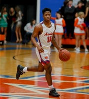 Marshall County's Zion Harmon brings the ball up the court  against Crawford County on Jan. 24, 2020.