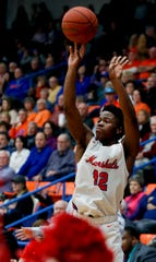 Marshall County's Zion Harmon knocks down a three against Crawford County on Jan. 24, 2020.