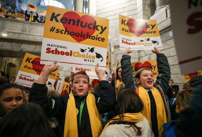 Students from six Kentucky Catholic and Christian schools wore yellow scarves as part of a rally for school choice at the state capitol rotunda Monday morning. Parents spoke about the benefits of charters schools and so did Sen. Ralph Alvarado and Attorney General Daniel Cameron. Jan. 27, 2020