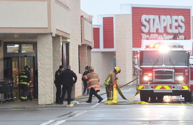 Firefighters respond to a call at Burlington department store in the Springfield Square on Monday evening.