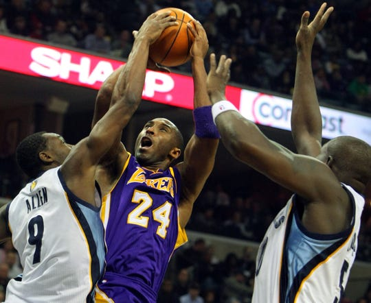 Nov. 20, 2010 - Los Angeles Lakers guard Kobe Bryant (24) is fouled by Memphis Grizzlies guard Tony Allen in the first half of an NBA basketball game in Memphis.
