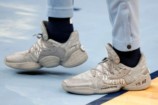 The Grizzlies' Marko Guduric wears shoes with a tribute message to Kobe Bryant while warming up Sunday.