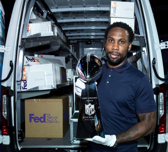 Former NFL wide receiver Anquan Boldin helped deliver the Vince Lombardi Trophy ahead of Super Bowl LIV in Miami.