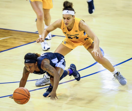Villanova forward Raven James and Marquette guard Selena Lott chase a loose ball in a Big East Conference women's basketball game Sunday, January 26, 2020, at the Al McGuire Center in Milwaukee  , Wisconsin.