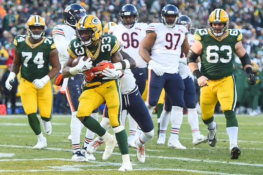Packers running back Aaron Jones rushes for a touchdown in the third quarter over Bears defensive back Kevin Toliver on Dec. 15, 2019, at Lambeau Field.