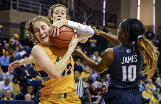 Marquette guard Lauren Van Kleunen wrestles a rebound away from Villanova guard Raven James in a Big East Conference women's basketball game Sunday, January 26, 2020, at the Al McGuire Center in Milwaukee  , Wisconsin.