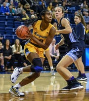Marquette forward Altia Anderson drives the baseline past Villanova forward Maddy Siegrist in a Big East Conference women's basketball game Sunday, January 26, 2020, at the Al McGuire Center in Milwaukee  , Wisconsin.
