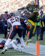 Chicago Bears defensive back Kevin Toliver (22) pushes Green Bay Packers wide receiver Davante Adams (17) out of bounds at the goal line during football game on Dec. 15,  at Lambeau Field,