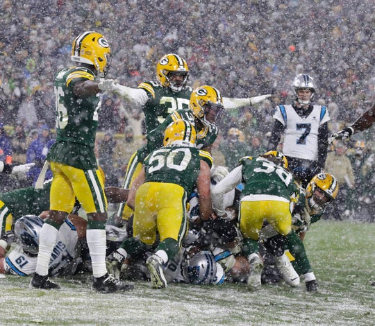 Members of the Packers defense celebrate as Panthers running back Christian McCaffrey (22) is unable to score as time expires in the fourth quarter of a 24-16 win over the Panthers on Nov. 10, 2019, at Lambeau Field.