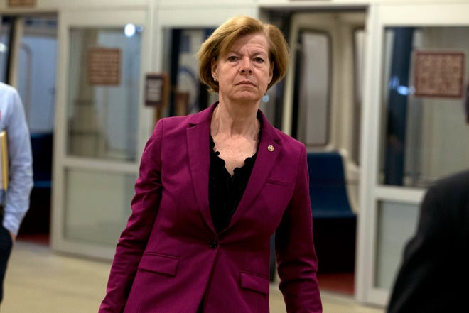 Sen. Tammy Baldwin, D-Wis., talks to reporters on her way to the Senate chamber on Capitol Hill in Washington, Tuesday, Jan. 21, 2020.