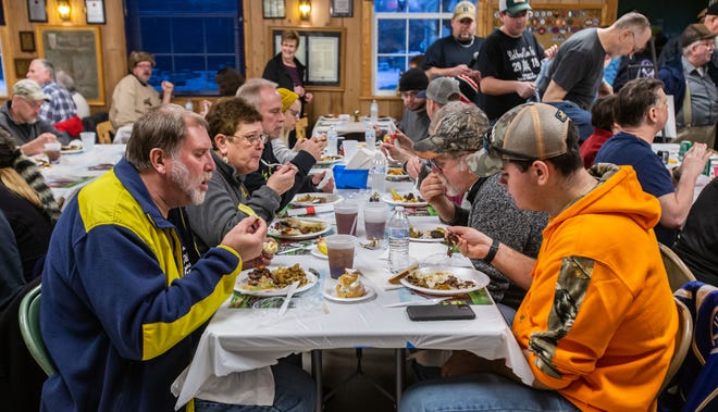 Diners sit shoulder to shoulder during the 94th annual Tom McNulty Memorial Coon Feed in Delafield. The 2021 event has been canceled because of COVID-19 concerns.