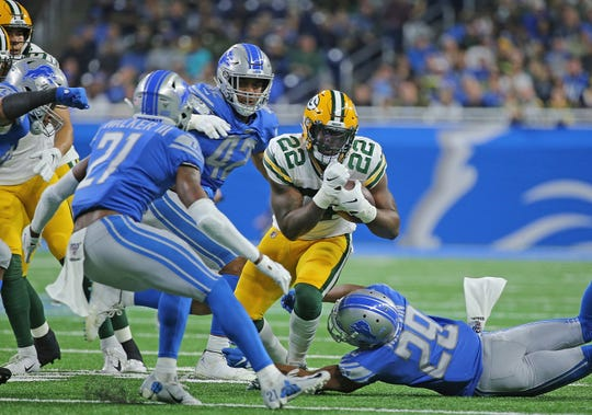 The Packers' Dexter Williams runs for a first down during the second quarter of the Dec. 29, 2019, game against the Detroit Lions at Ford Field.