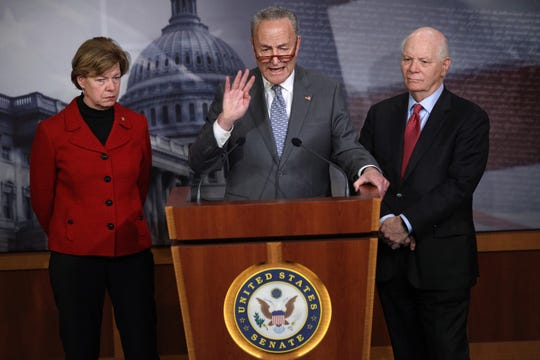 U.S. Sen. Tammy Baldwin, left, of Wisconsin joins Senate Minority Leader Sen. Chuck Schumer of New York and Sen. Ben Cardin of Maryland in calling for testimony from former national security adviser John Bolton in the impeachment trial of President Donald Trump. The Democrats held a news conference at the U.S. Capitol January 27, 2020.