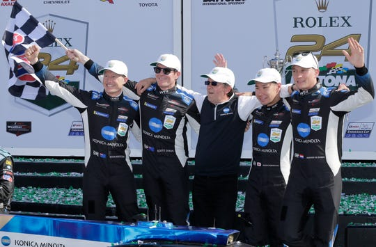 Team owner Wayne Taylor (center) celebrates drivers (from left) Ryan Briscoe, Scott Dixon, Kamui Kobayashi and Renger van der Zande after they drove his Konica Minolta Cadillac DPi-V.R. to victory at the Rolex 24 at Daytona on Sunday.