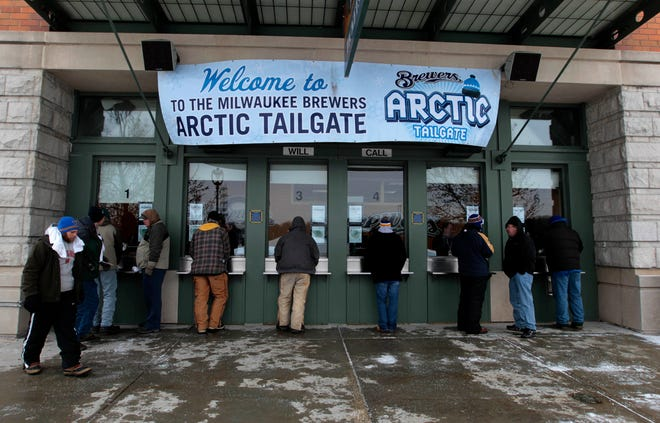 Cold weather usually doesn't keep fans from showing up during the Milwaukee Brewers Arctic Tailgate event. Journal Sentinel file photo by Rick Wood