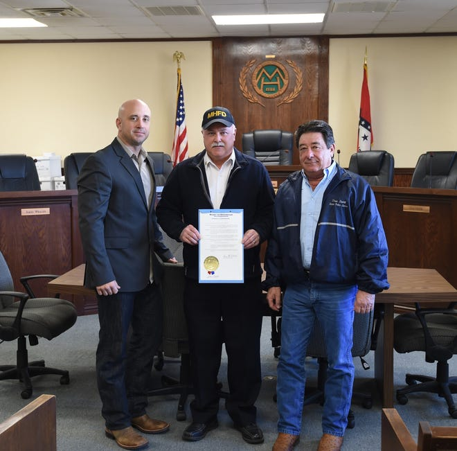 """Gov. Asa Hutchinson proclaimed Jan. 27 to be """"Firefighter Recognition Day"""" across the state of Arkansas, and the day was observed in Mountain Home by Doug Smith, the governor's public safety liaison, reading the proclamation Monday at Mountain Home City Hall. Shown above with the proclamation are (from left) Eric Setzer, president of the Mountain Home Professional Firefighter's Association #4496; Mountain Home Fire Chief Ken Williams and Doug Smith, public safety liaison for Gov. Asa Hutchinson."""