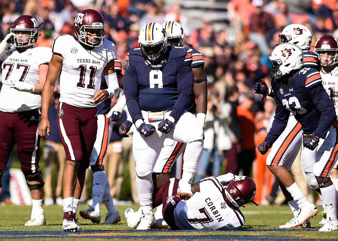 Auburn defensive tackle Coynis Miller Jr. (8) celebrates a stop against Texas A&M on Saturday, Nov. 3, 2018, in Auburn, Ala.