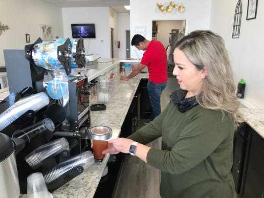 Marisol Lozoya prepares an energy tea at her shop, The 'Boro Nutrition and Energy, 2089 Lascassas Pike in Murfreesboro.