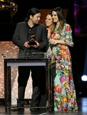"Aaron Raitiere, from left, Hillary Lindsey, and Natalie Hemby accept the award for best song written for visual media for ""I'll Never Love Again (Film Version)"" from ""A Star Is Born"" at the 62nd annual Grammy Awards on Sunday, Jan. 26, 2020, in Los Angeles. Raitiere is a graduate of Middle Tennessee State University."