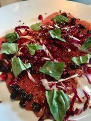 Tuna carpaccio with radicchio, puffed quinoa and pomegranate at Santo in Green Hills.