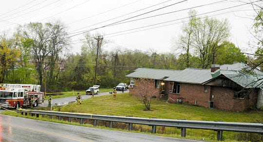 Pictured in 2015: The duplex at 109 McFarland Lane at the intersection of North Charlotte Street and Henslee Drive where Chris Goldtrap and Lisa Wade Mackenzie McDonald were found killed by gunshot after firefighters put out the fire.