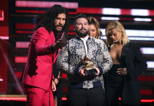 Dan Smyers, left, and Shay Mooney, of Dan + Shay, accept the award for best country duo/group performance at the 62nd annual Grammy Awards on Sunday, Jan. 26, 2020, in Los Angeles.
