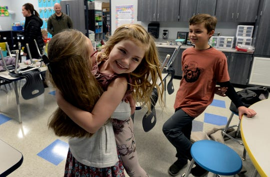 Claire Smith, 8, hugs her friend Kennedy Francoforte, 6, in Vincent Meek's first grade classroom during the Creekside Elementary School open house Sunday, Jan. 26, 2020, in Franklin.