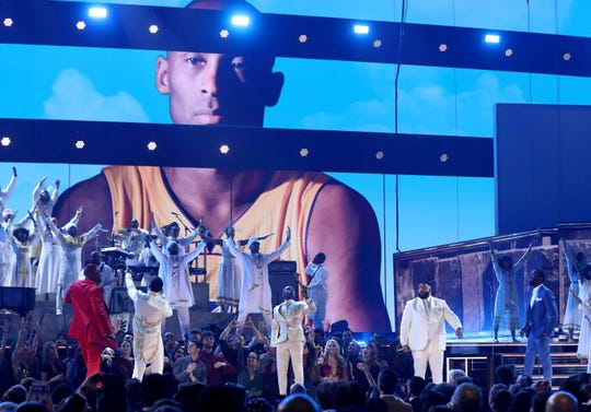 YG, from left, John Legend, Kirk Franklin, DJ Khaled and Meek Mill perform during a tribute in honor of the late Nipsey Hussle at the 62nd annual Grammy Awards on Sunday, Jan. 26, 2020, in Los Angeles.