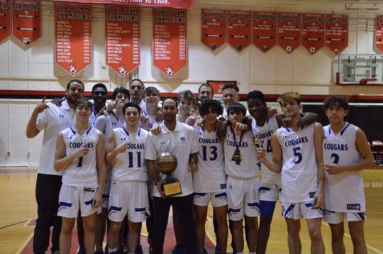 The Barron Collier basketball team poses for a picture after winning the red bracket at the SWFL Sunshine Showdown, held at North Fort Myers High School.