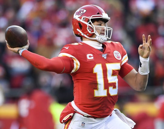 Kansas City Chiefs quarterback Patrick Mahomes (15) throws a pass against the Tennessee Titans during the second quarter of the AFC Championship game at Arrowhead Stadium on  Jan. 19 in Kansas City, Missouri.